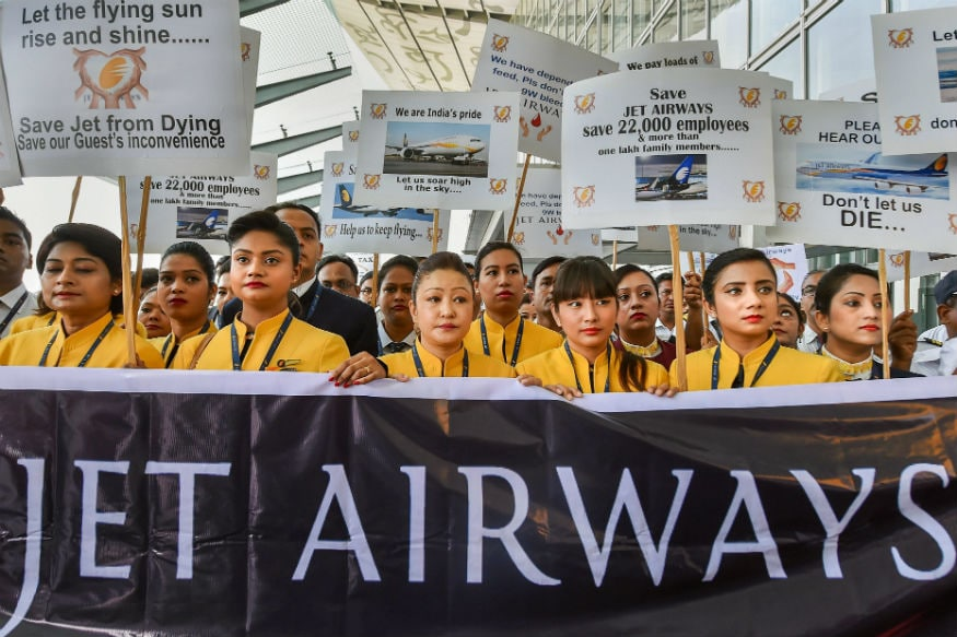 Jet Airways employees display placards as they gather to make an appeal for saving the cash-starved airline following the shutdown of its operations.  (PTI)