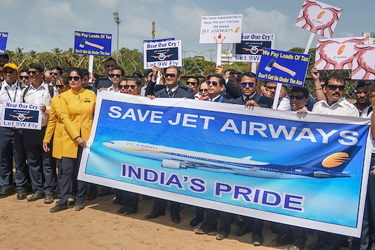 Jet Airways employees stage a silent protest at Azad Maidan, in Mumbai. (Image: PTI)