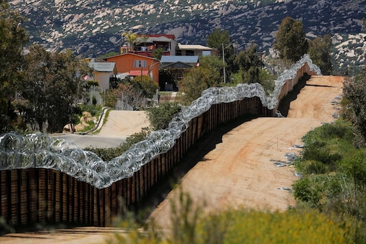The border wall between the US and Mexico is shown from the US side near Tecate, California. (Image: REUTERS)