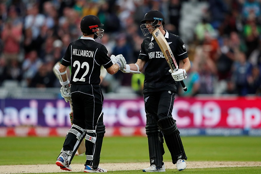 NZ's Mitchell Santner (right) congratulates Kanes Williamson after his hundred against South Africa. (Pic: Reuters)