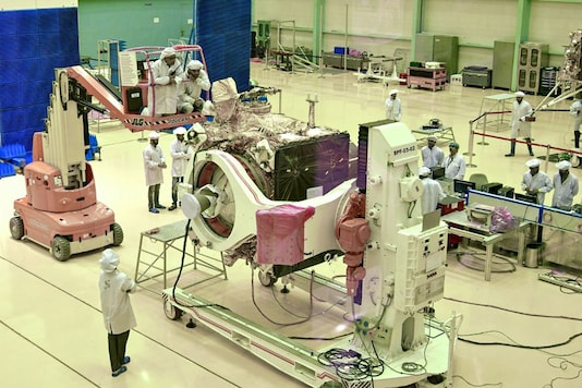 ISRO scientists work on the orbiter vehicle of 'Chandrayaan-2', India's first moon lander and rover mission planned and developed by the ISRO, in Bengaluru. (Image: AFP)