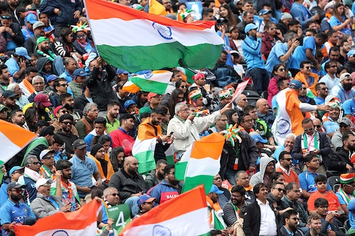 Indian fans cheer for their team during the Cricket World Cup match between India and Pakistan at Old Trafford in Manchester, England. (Image: AP)