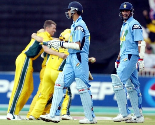 India's Zaheer Khan (right) and Ashish Nehra trudge off as Australia celebrate after winning the 2003 World Cup final in Johannesburg (Pic: AFP)