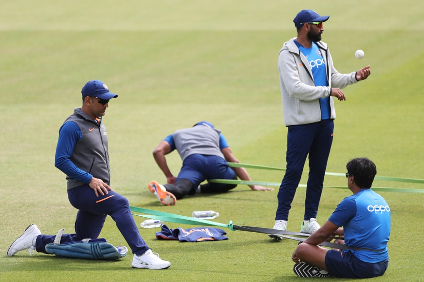 MS Dhoni performs stretching exercises during a training session ahead of their Cricket World Cup semifinal match against New Zealand at Old Trafford in Manchester, England. (Image: AP)