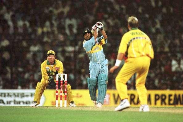 India's Sachin Tendulkar goes after Shane Warne of Australia in the 1996 World Cup match in Mumbai