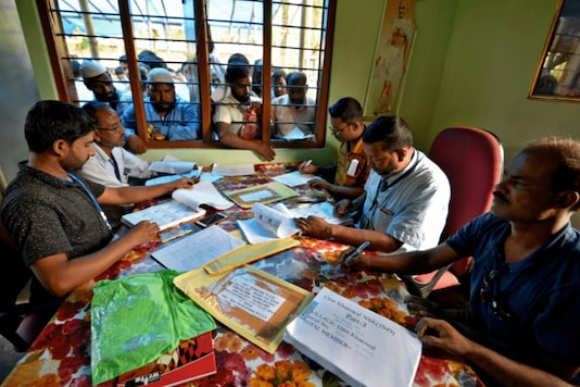 People wait to check their names on the draft NRC list at a centre in Nagaon district, Assam. (Reuters/File photo)