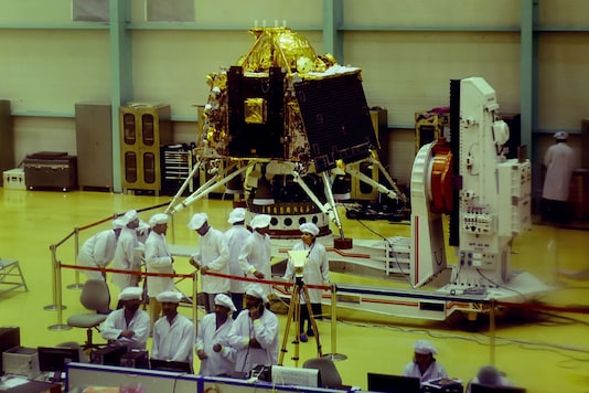ISRO personnel work on the orbiter vehicle of Chandrayaan-2 in Bengaluru. (PTI)