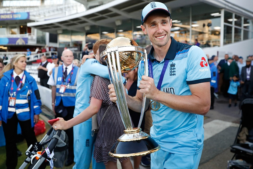 Chris Wakes holds the trophy as he celebrates after winning the Cricket World Cup final match between England and New Zealand at Lord's cricket ground in London. (Image: AP)