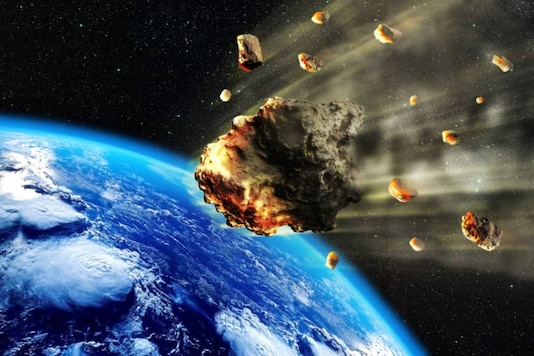 File image of an artist's illustration of asteroids approaching Earth. (Image: Getty Images)