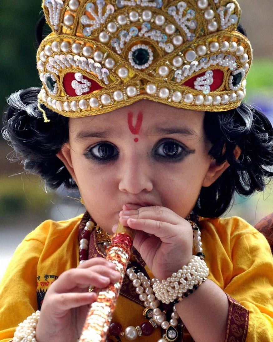A child dressed as Lord Krishna