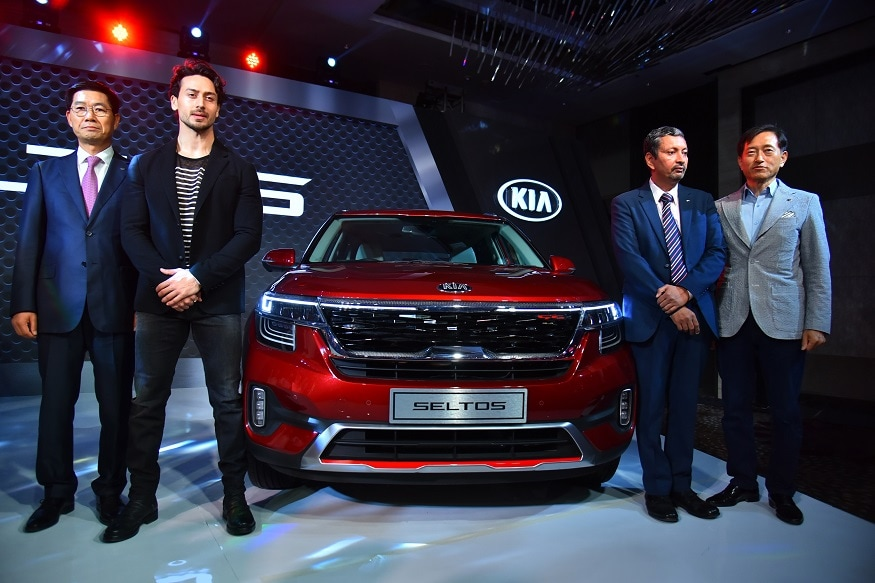 (L-R) Mr Kookhyun Shim Bollywood actor Tiger Shroff Mr Yong S Kim and Mr Manohar Bhat at the launch of Kia Seltos