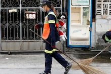 Bangkok Street Sweeper Goes Viral For Carrying Her Pet Dog to Work