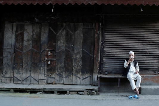 A man sips tea sitting outside a closed shop in Srinagar during the clampdown in the restive region. (Image for representation/Reuters)