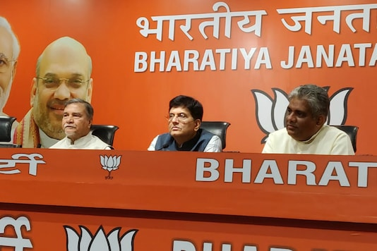 A file photo of Bhubaneswar Kalita (left) joining the BJP.