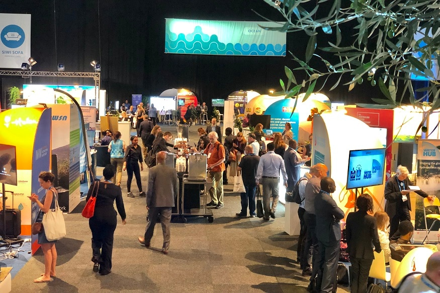 Participants inform themselves about various water issues at pop-up installations at World Water Week in Stockholm.