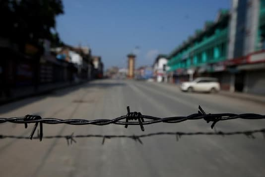 Barbed wire is seen laid on a deserted road during restrictions in Srinagar. (Photo Credit: Reuters)