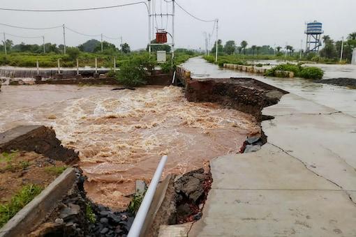 A damaged road after heavy monsoon downpour, in Mandsaur, Madhya Pradesh. (PTI Photo)