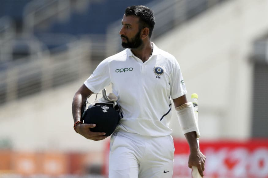 Cheteshwar Pujara leaves the field after his dismissal (AP Photo/Ricardo Mazalan)