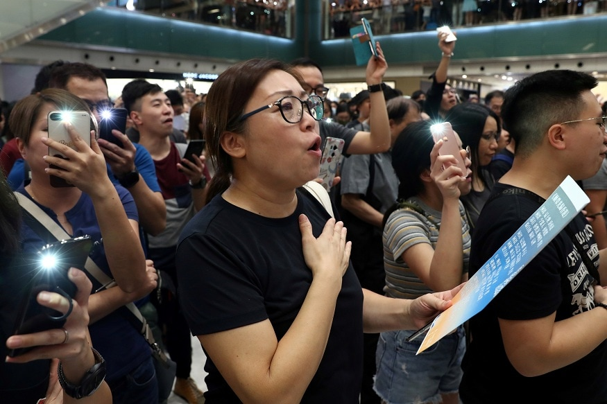 People chant as they gather during a protest at New Town Plaza shopping mall in Hong Kong