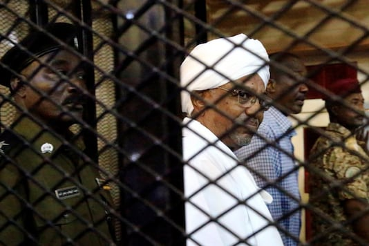 File photo: Sudan's former president Omar Hassan al-Bashir sits inside a cage at the courthouse where he is facing corruption charges, in Khartoum, Sudan August 31, 2019. REUTERS/Mohamed Nureldin Abdallah
