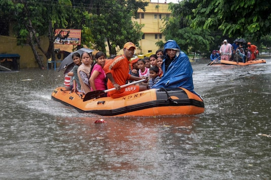 State Disaster Response Force (SDRF)  workers rescue people from flood-affected area of Bahadurpur following heavy monsoon rainfall, in Patna on Sunday. (PTI)