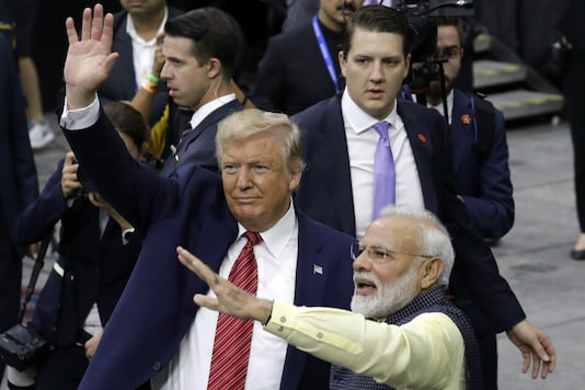 US President Donald Trump and Prime Minister Narendra Modi walk around NRG Stadium waving to the crowd during the 'Howdy, Modi' event, on September 22 in Houston. (AP Photo: Evan Vucci)