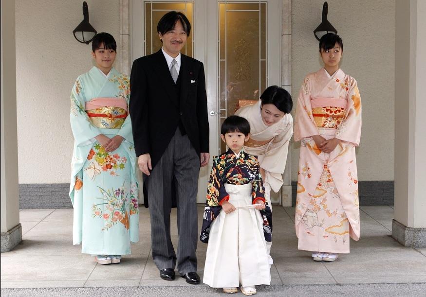 FILE PHOTO: Japan's Prince Hisahito, son of Prince Akishino and Princess Kiko, is accompanied by his parents after the Chakko-no-Gi and Fukasogi-no-gi ceremonies in Tokyo