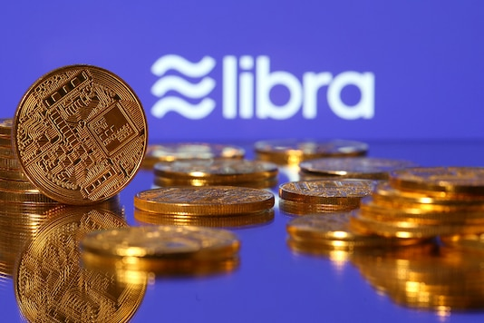 Representations of virtual currency are displayed in front of the Libra logo.  (REUTERS/Dado Ruvic/Illustration/File Photo)