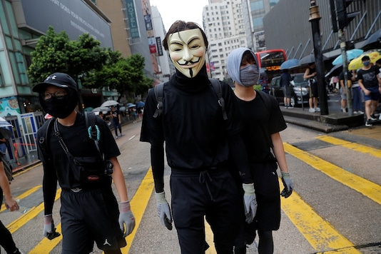 Masked anti-government protesters attend a demonstration in Tsim Sha Tsui district, in Hong Kong, October 6, 2019. (Reuters)