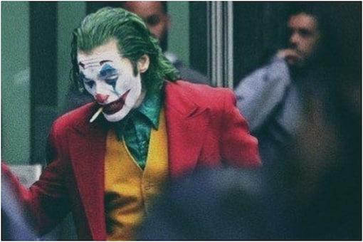 Image of Joaquin Phoenix as Joker.