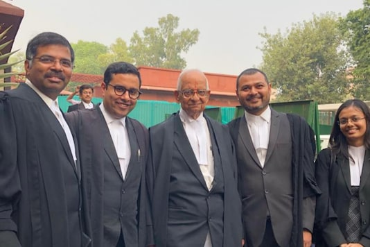 File photo of veteran lawyer K Parasaran (centre)  with his associates at the Supreme Court. (News18)