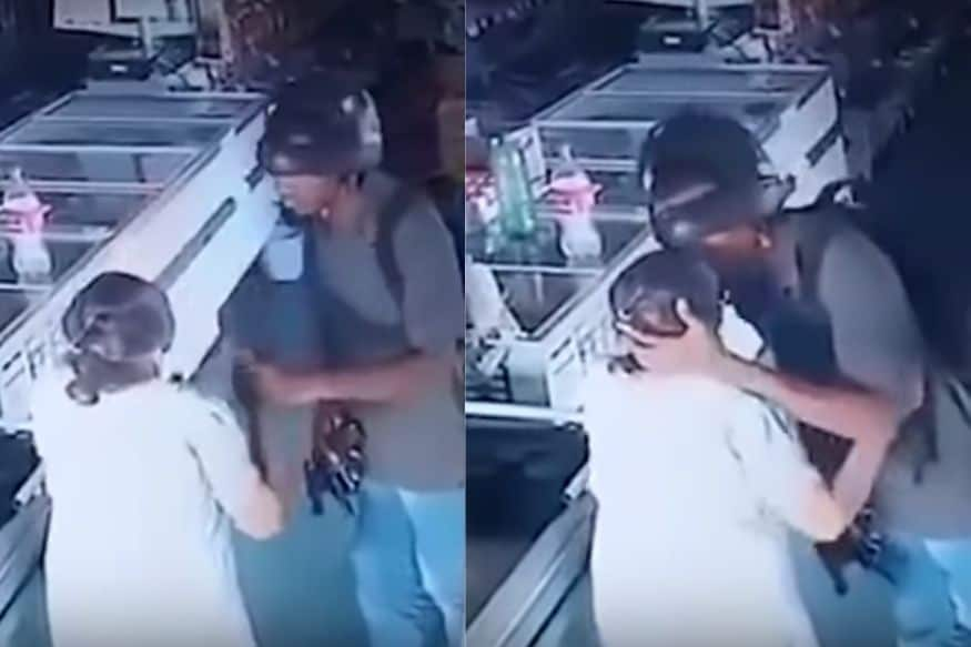 Watch: Burglar Kisses Elderly Woman to Calm Her During Robbery in Pharmacy