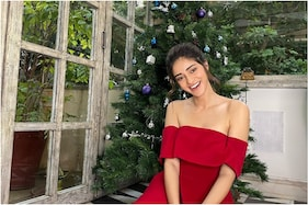 Ananya Panday Soaks in Christmas Spirit in Red Off-shoulder Dress