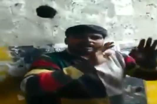 Man being assaulted in Greater Noida for selling Biryani. (Image: ANI/Twitter)