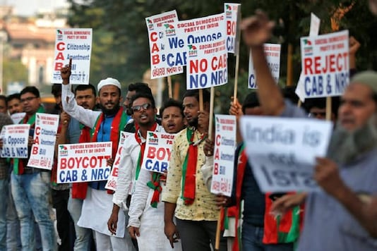 Demonstrators display placards and shout slogans during a protest against the Citizenship Amendment Bill, a bill that seeks to give citizenship to religious minorities persecuted in neighbouring Muslim countries, in Ahmedabad. (Reuters Photo)
