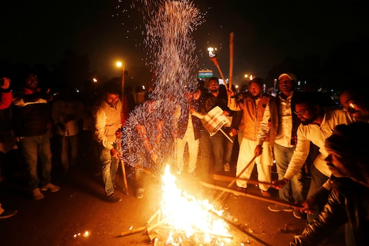 Members of  Congress party burn a copy of Citizenship Amendment Bill during a protest in New Delhi on December 11, 2019. (Reuters)
