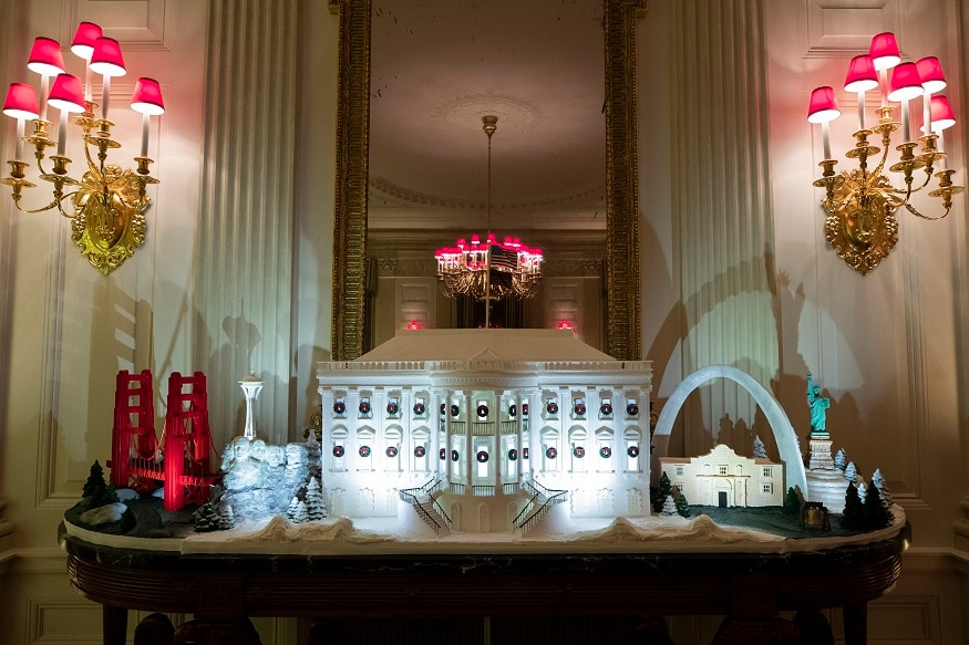 The White House made of gingerbread also features landmarks from around the country in the State Dinning Room during the 2019 Christmas preview at the White House, Monday, Dec. 2, 2019, in Washington. (AP Photo/Alex Brandon)