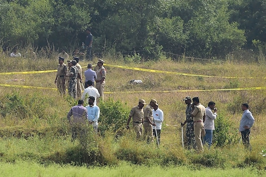 Policemen stand guard the area where four accused in the rape-and-murder case of a 25-year-old woman veterinarian were shot dead by police, at Shadnagar of Ranga Reddy district in Hyderabad. (Image: PTI)