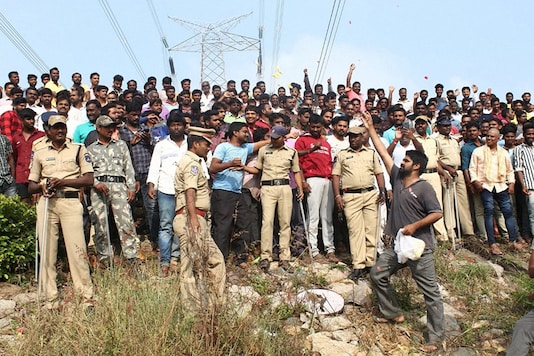 People shower flower petals and raise slogans in favour of police at the encounter site where the four accused in the rape-and-murder case of a 26-year-old veterinarian were shot dead in an encounter in Hyderabad. (PTI)