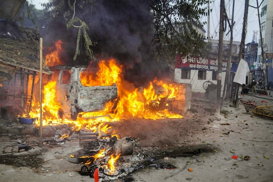 A vehicle torched allegedly by protestors during a demonstration against the Citizenship Amendment Act (CAA), in Kanpur, Saturday (PTI)