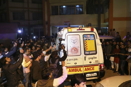 An ambulance carrying the Unnao rape survivor, who was set afire earlier today,  to be air-lifted from Civil Hospital in Lucknow to Delhi, in Lucknow, Thursday. (PTI Photo)