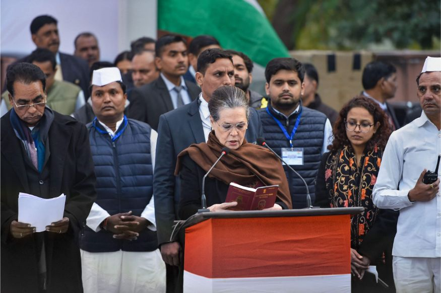 Congress interim president Sonia Gandhi reads from the Indian Constitution during the 'satyagraha' demanding protection for the Constitution in the view of CAA and NRC, at Mahatma Gandhi's samadhi Rajghat in New Delhi. (Image: PTI)