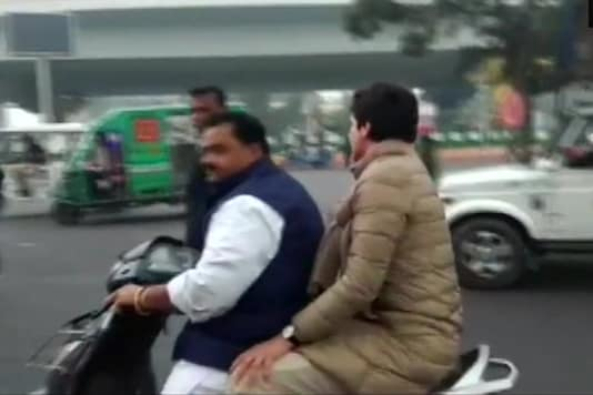 Congress leader Priyanka Gandhi Vadra rides pillion with party worker in Lucknow on Saturday. (Image creditL ANI Twitter)