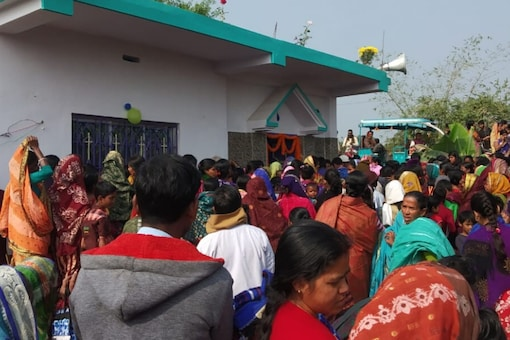 Villagers gather outside the church at Bhagwanpur in East Midnapore district. (News18)