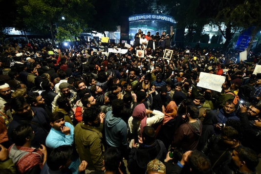 Students protest against the police action at Jamia Millia Islamia University, outside the Delhi Police headquarters in New Delhi on December 15, 2019. (PTI)