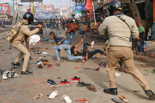 A file photo of anti-CAA protesters and police personnel clashing in Lucknow.