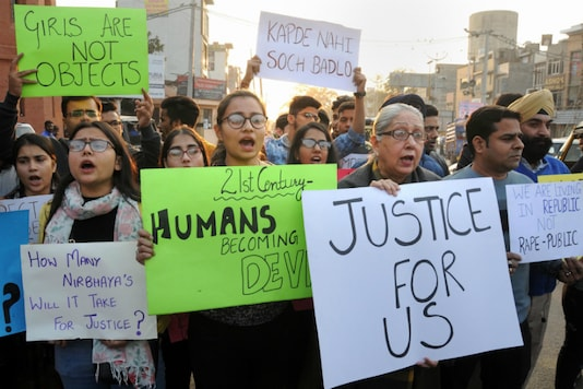 Students and members of Voice of Amritsarhold placards during a protest demandingjusticefor the rape and murder of a 25-year-old veterinarian in Hyderabad. (PTI)