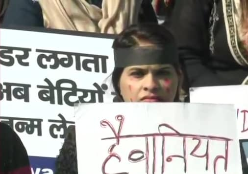 A woman protests at Jantar Mantar in New Delhi over increase in crimes against women.