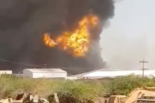 Smoke billows at a ceramics factory after an explosion in Khartoum. (Reuters)