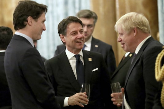 Britain's Prime Minister Boris Johnson talks to Canadian Prime Minister Justin Trudea left, and Italian Prime Minister Guiseppe Conte during a reception at Buckingham Palace, as NATO leaders gather to mark 70 years of the alliance, in London, Tuesday, December 3, 2019. AP/PTI